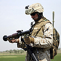 A Marine Looks At A Brand New by Stocktrek Images