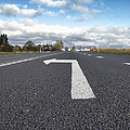 A Metalled Road With A Large by Jaak Nilson