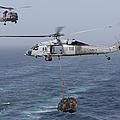 A Mh-60s Knighthawk Transfers Cargo by Gert Kromhout