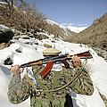 A Mujahadeen Guard Walks With U.s by Stocktrek Images