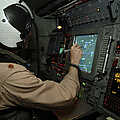 A Naval Flight Officer Tracks Aircraft by Stocktrek Images
