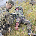 A Patrol Medic Applies First Aid by Andrew Chittock