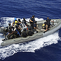 A Rigid-hull Inflatable Boat Carrying Print by Stocktrek Images