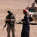 A Soldier Communicates With A Local by Stocktrek Images
