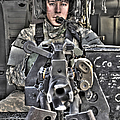 A Uh-60 Black Hawk Door Gunner Manning Poster by Terry Moore