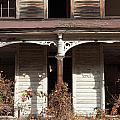 Abandoned House Facade Rusty Porch Roof by John Stephens