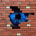 Abstract Of Eye Looking Through Hole In Brick Wall by Mehau Kulyk