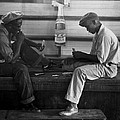 African American Young Men Play A Card by Everett