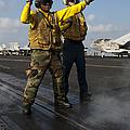 Airmen Direct An Fa-18c Hornet Print by Stocktrek Images