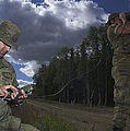 Airmen Use A Range Finder And Gps Unit by Stocktrek Images