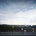 Airplane On Runway by Shannon Fagan