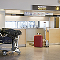 Airport Baggage Area by Jaak Nilson