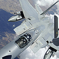 An F-15 Eagle Pulls Away From A Kc-135 by Stocktrek Images