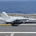 An Fa-18c Hornet Lands Aboard Uss by Stocktrek Images