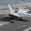 An Fa-18f Super Hornet Traps An Print by Stocktrek Images