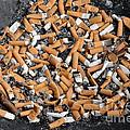 Ashtray full of cigarette stubs