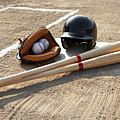 Baseball Glove, Balls, Bats And Baseball Helmet At Home Plate by Thomas Northcut