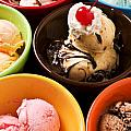 Bowls of different flavor ice creams Print by Garry Gay