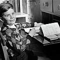 Boy Indoor At Desk by George Marks