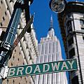 Broadway Sign And Empire State Building by Axiom Photographic