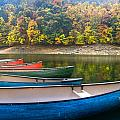 Canoes At Fontana by Debra and Dave Vanderlaan