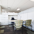 Chairs And Desk In Office Cubicle by Jetta Productions, Inc