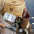 Close-up Of Fishing Equipment And Hat  by Sandra Cunningham