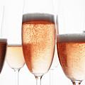 Close Up Of Glasses Of Champagne by Brett Stevens