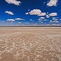 Clouds Float In A Blue Sky Above A Dry by Jason Edwards