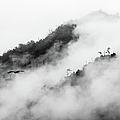 Clouds Surrounding Mountains by Ruben Sanchez Photography