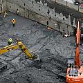Construction Site Diggers And Workmen In The Foundation Pit Of A New Building Seattle by Andy Smy