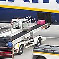 Conveyor Unloading Luggage by Jaak Nilson
