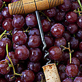 Corkscrew And Wine Cork On Red Grapes by Garry Gay