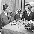 Couple Toasting At Dinner Table, (b&w), Elevated View by George Marks