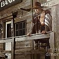 Cowboy Waiting Outside of a Bank Building Print by Oleksiy Maksymenko