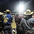 Cowboys At Rodeo by John Greim