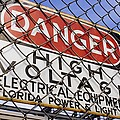 Danger High Voltage Sign In Cocoa Florida by Mark Williamson