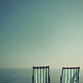 Deck Chairs On Brighton Beach by Paul Grand Image