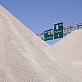 Dirt Mounds With Highway Signs In Background by Jeremy Woodhouse