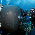 Divers Prepare To Launch A Seal by Stocktrek Images