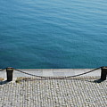 Dock Chain By Pavement by Photography by Kévin Niglaut