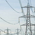 Electricity Pylons Against A Clear Blue by Iain  Sarjeant