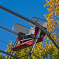Empty Chair On Ferris Wheel by Thom Gourley/Flatbread Images, LLC