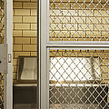 Empty Jail Holding Cell by Jeremy Woodhouse