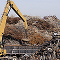 Excavator Moving Scrap Metal with Electro Magnet Print by Jeremy Woodhouse