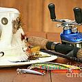 Fishing Reel With Hat And Color Lures by Sandra Cunningham