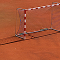 Football Net On Red Ground by Daniel Kulinski