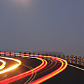 Full Moon Over A Curving Road by Jetta Productions, Inc