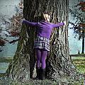 Girl Hugging Tree Trunk by Joana Kruse