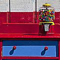 Gum Ball Machine On Red Desk by Garry Gay